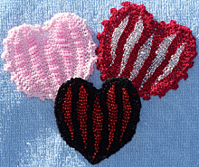 Image of 3 finished Bead Knitted Hearts